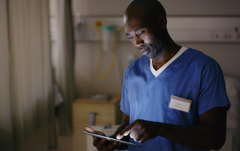 Shot of a medical practitioner using a digital tablet in a hospital ward