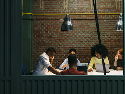Team at work. Group of business people working and communicating together in creative office.