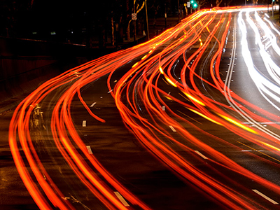 Long exposure showing the flow of multiple lanes of busy on a multi-lane urban road.